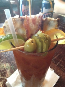 "Wife's Bloody Mary.  Cheeseburger was hot and good!  And the pickles were ""on a stick""."