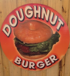 This looks like a Krispy Kreme cut in half with a burger and some healthy lettuce and tomato inserted.  Wins just because it makes you gag looking at it.  (Edged out the Pork Doughnut (Bismark filled with Pork).